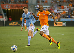 July 18, 2018 - Houston, TX, U.S. - HOUSTON, TX - JULY 18:  Houston Dynamo defender Adolfo Machado (3) keeps the ball ahead of Sporting Kansas City midfielder Ilie Sanchez (6) during the US Open Cup Quarterfinal soccer match between Sporting KC and Houston Dynamo on July 18, 2018 at BBVA Compass Stadium in Houston, Texas. (Photo by Leslie Plaza Johnson/Icon Sportswire) (Credit Image: © Leslie Plaza Johnson/Icon SMI via ZUMA Press)