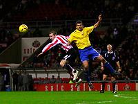Photo: Andrew Unwin.<br />Sunderland v Preston North End. Coca Cola Championship. 30/12/2006.<br />Sunderland's Stephen Elliott (L) battles for the ball against Preston's Callum Davidson (R).