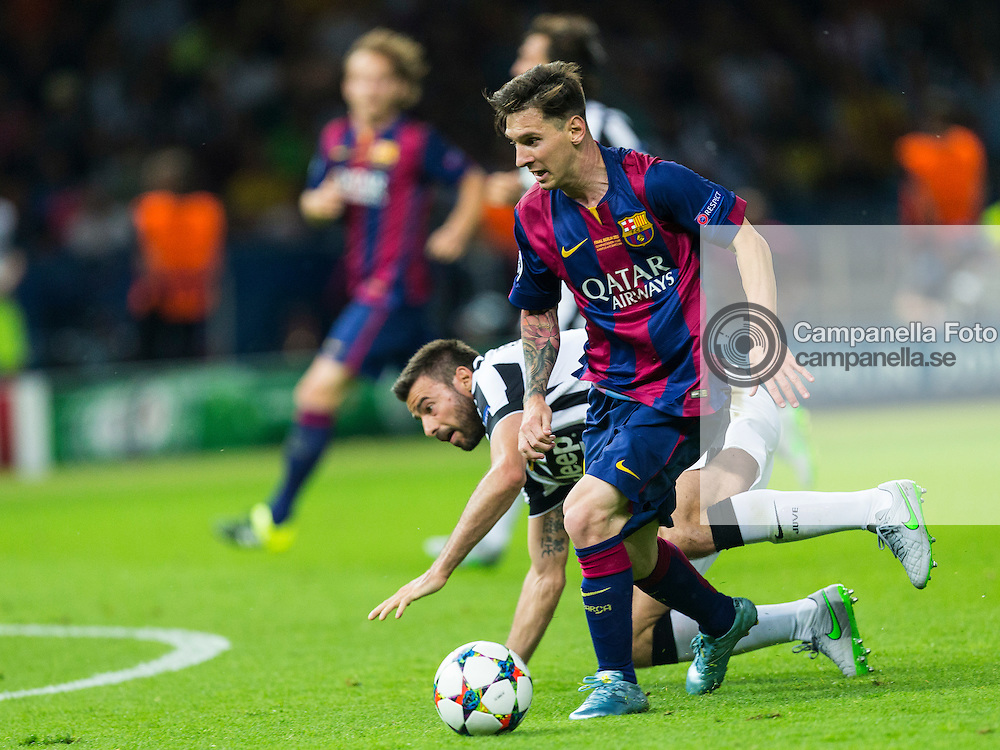 BERLIN, GERMANY - June 6th 2015:<br /> <br /> Barcelona 10 Lionel Messi assists the 2-0 goal during the UEFA Champions League Final between Juventus FC and FC Barcelona at Olympiastadion in Berlin, Germany on June 6th 2015. (Photo: Michael Campanella)