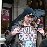 A protester is proud to show off his shirt with a print of Thatcher that he personally created. Trafalgar square, London.