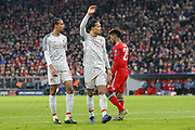 Liverpool defender Virgil van Dijk (4) signals for the ball before a corner-kick during the Champions League match between Bayern Munich and Liverpool at the Allianz Arena, Munich, Germany, on 13 March 2019.
