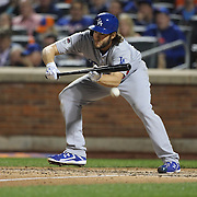 Clayton Kershaw, Los Angeles Dodgers, bunting during the New York Mets Vs Los Angeles Dodgers, game four of the NL Division Series at Citi Field, Queens, New York. USA. 13th October 2015. Photo Tim Clayton