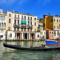 Gondola on Grand Canal in Venice, Italy <br /> Venice is built on 100 islands that are connected by 170 canals.  It is impossible to get lost because if you walk long enough you will reach one of the major waterways.  Practically speaking, however, it is easy to get lost once inside the catacomb of alleys connected by endless footbridges.  Fortunately, there is always a gondola nearby that will come to your rescue ... for a hefty fee of course.