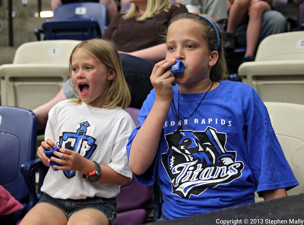 Alyssa Krueger, 7, and Halie Krueger, 10, both of Cedar Rapids make some noise during the game at the Cedar Rapids Ice Arena in Cedar Rapids on Saturday, June 8, 2013.