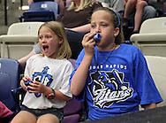 Alyssa Krueger, 7, and Halie Krueger, 10, both of Cedar Rapids make some noise during the game at the Cedar Rapids Ice Arena in Cedar Rapids on Saturday, June 8, 2013.