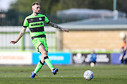 Forest Green Rovers Carl Winchester(7) passes the ball forward during the EFL Sky Bet League 2 match between Forest Green Rovers and Macclesfield Town at the New Lawn, Forest Green, United Kingdom on 13 April 2019.