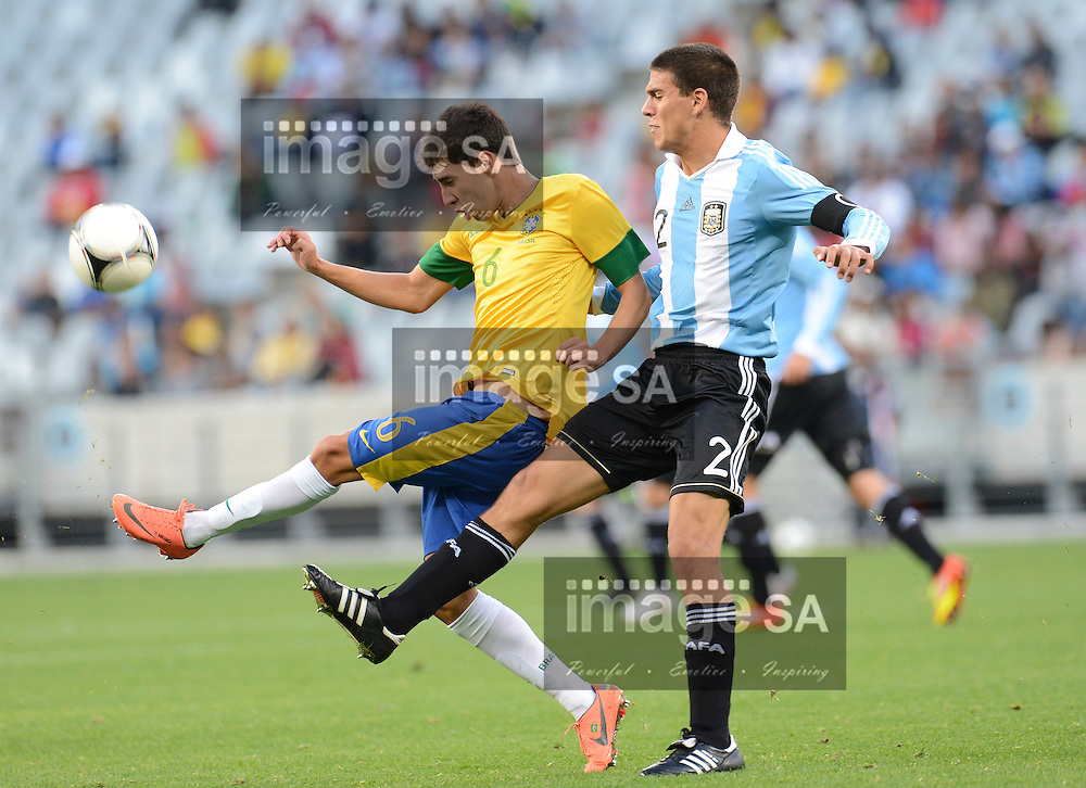 CAPE TOWN, SOUTH AFRICA: Sunday 3 June 2012, HENRIQUE MIRANDA RIBEIRO of Brasil is challenged by LISANDRO MAGALLAN of Argentina during the final of the under 20 Cape Town International Soccer Challenge between Argentina and Brazil at the Cape Town Stadium..Photo by Roger Sedres/ImageSA