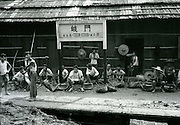 C005-2_Tom Hutchins_Railway workers resting at Qi Men station, main Canton-Hankow railway line, Hunan, China 1956 A3.tif