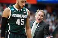 29 MAR 2015: Coach Tom Izzo of Michigan State University yells to player Denzel Valentine (45) against the University of Louisville during the 2015 NCAA Men's Basketball Tournament held at the Carrier Dome in Syracuse, NY. Michigan State defeated Louisville 76-70 to advance. Brett Wilhelm/NCAA Photos