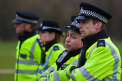 Hyde Park, London, April 19th 2015. Hundreds of cannabis users and their supporters gather at Speaker's Corner in Hyde Park for the annual London 420 pro-cannabis rally, under the watcful eye of Metropolitan Police officers, who kept a reasonably low profile, allowing the rally to continue without any serious incidents. PICTURED: Met Police officers look on as up to 2,000 cannabis smokers enjoy their day in the park.