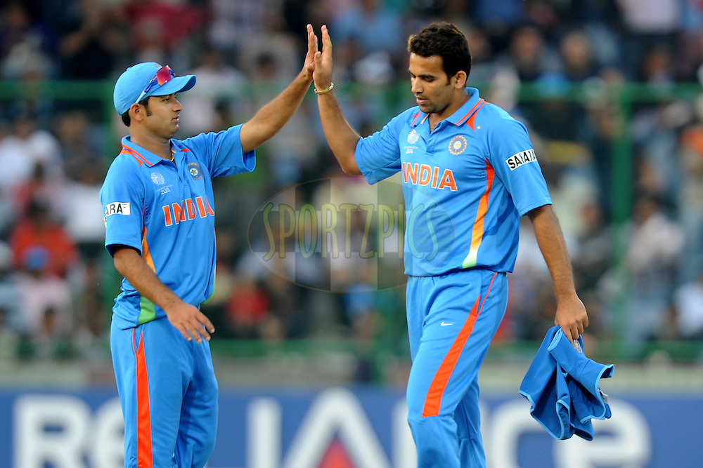 Zaheer Khan of India  celebrate the wicket of Mudassar Bukhari of The Netherlands during the ICC Cricket World Cup match between India and The Netherlands held at the Feroz Shah Kotla, Delhi Stadium in Delhi, India on the 9 March 2011..Photo by Pal Pillai/BCCI/SPORTZPICS