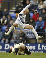 Photo: Aidan Ellis.<br /> Bolton Wanderers v Blackburn Rovers. The Barclays Premiership. 04/03/2007.<br /> Bolton's Stellios leaps out of the way of Rovers keeper Brad Friedel