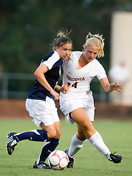 Georgetown Hoyas midfielder Kelly D'Ambrisi (17) gets away with a tug on the shirt of Virginia Cavaliers defender Colleen Flanagan (24).  The #6 Virginia Cavaliers played the Georgetown Hoyas to a 2-2 draw in a NCAA Women's Soccer pre-season exhibition game held at Klockner Stadium on the Grounds of the University of Virginia in Charlottesville, VA on August 18, 2008.