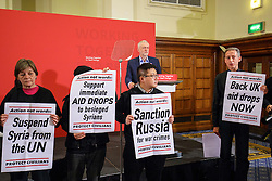 © Licensed to London News Pictures. 10/12/2016. London, UK. Labour leader and the leader of opposition JEREMY CORBYN is interrupted by 'Syria Solidarity UK' protesters whilst speaking on human rights at the Methodist Central Hall in Westminster, London on Saturday, 10 December 2016. Photo credit: Tolga Akmen/LNP