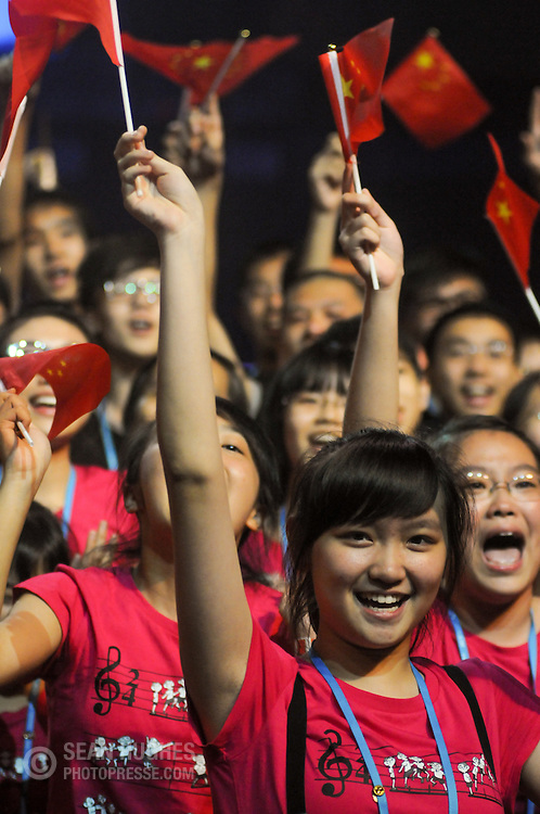 Members of the Guangdong Experimental Middle School Choir, China celebrate their victory in the Youth Choirs of Equal Voices category during the first of four Award Ceremonies at the World Choir Games, July 7, 2012. This is the choir's tenth gold medal and fifth championship, making them the most decorated choir in the Games' history. (Photo: Sean Hughes)