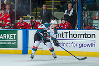 KELOWNA, CANADA - APRIL 8: James Hilsendager #2 of the Kelowna Rockets passes the puck in front of the Portland Winterhawks' bench on April 8, 2017 at Prospera Place in Kelowna, British Columbia, Canada.  (Photo by Marissa Baecker/Shoot the Breeze)  *** Local Caption ***