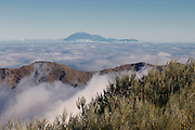 Above the clouds on the rim of the Volcano de Taburiente with the El Teide in the background, La Palma, Canaray islands,Spain