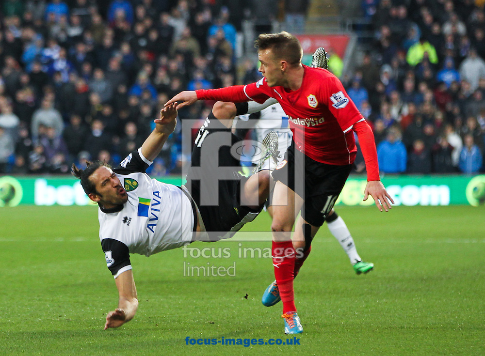 Picture by Tom Smith/Focus Images Ltd 07545141164<br /> 01/02/2014<br /> Jon&aacute;s Guti&eacute;rrez (left) of Norwich City crashes into Craig Noone (right) during the Barclays Premier League match at the Cardiff City Stadium, Cardiff.