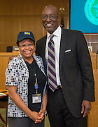 Houston ISD Interim Superintendent presents Janice Dunigan with a Team HISD cap during a central office staff meeting, May 17, 2016.