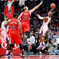 12 December 2016: LA Clippers guard Chris Paul (3) goes for the jump shot over Portland Trail Blazers center Mason Plumlee (24) during the LA Clippers 121-120 victory over the Portland Trail Blazers, at the Staples Center, Los Angeles, California, USA.