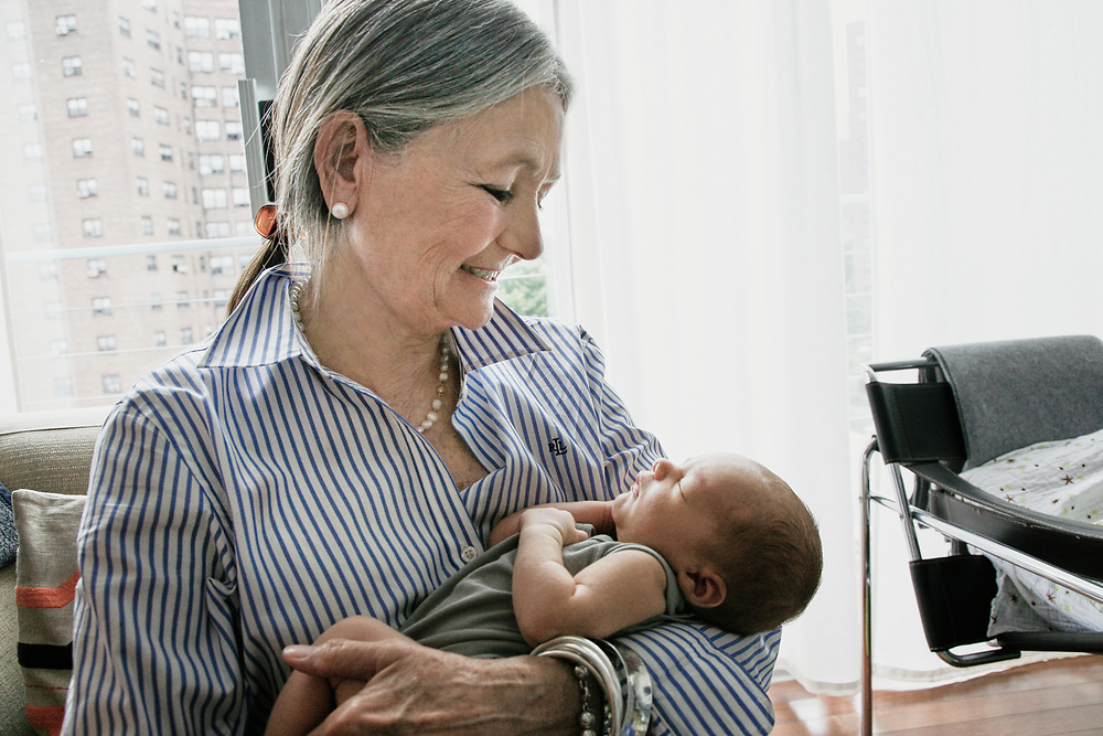 Grandmother caring for sleeping infant at home