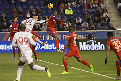 March 1, 2018 - Harrison, New Jersey, United States - Kevin Alvarez (2)) of CD Olimpia of Honduras & Aurelien Collin (78) of New York Red Bulls fights for ball during 2018 CONCACAF Champions League round of 16 game at Red Bull arena, Red Bulls won 2 - 0  (Credit Image: © Lev Radin/Pacific Press via ZUMA Wire)