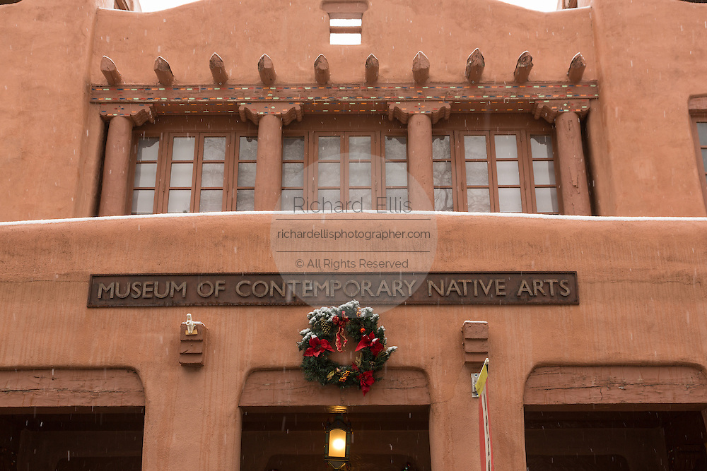 The adobe style Museum of Contemporary Native Arts in the historic district during a winter snowfall December 12, 2015 in Santa Fe, New Mexico.