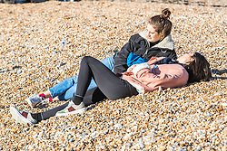 © Licensed to London News Pictures. 19/01/2020. Brighton, UK. Members of the public take advantage of the sunny but cold conditions to head out to the beach in Brighton and Hove. Photo credit: Hugo Michiels/LNP