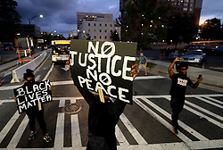 September 21, 2016 - Charlotte, North Carolina, U.S. - Protestors block an intersection near the Transit Center as they march uptown. The protestors were rallying against the fatal shooting of Keith Lamont Scott by police on Tuesday evening in the University City area. (Credit Image: © Jeff Siner/TNS via ZUMA Wire)
