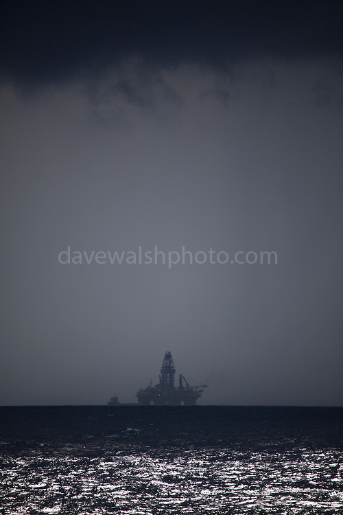 Transocean Development Driller rig at Deepwater Horizon disaster Site, beneath an impending squall. Photograph made on board the Greenpeace ship Arctic Sunrise, September 2010.