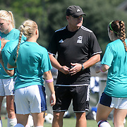 UNCW Head Coach Paul Cairney gives direction against Elon Sunday October 5, 2014. (Jason A. Frizzelle)