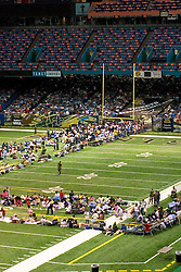 28th August, 2005. Hurricane Katrina, New Orleans, Louisiana. Thousands of people seek shelter inside the New Orleans Saints' Superdome the night before the storm hit. Officials brought people in from the rain and searched them for drugs, weapons and alcohol before permitting them inside the Superdome.