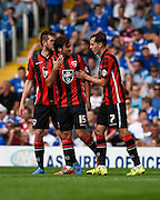 Morecambe players celebrate Tom Barkhuizen's opening goal during the Sky Bet League 2 match between Portsmouth and Morecambe at Fratton Park, Portsmouth, England on 22 August 2015. Photo by David Charbit.