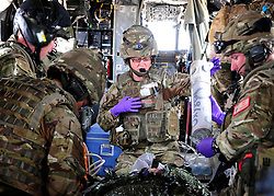 © Licensed to London News Pictures. 17/01/12. FILE PICTURE The MOD has announced Up to 2,900 Army, 1,000 RAF and 300 Royal Navy staff to be made redundant in latest UK defence cuts.11/06/11. AFGHANISTAN. The RAF Regiment's Medical Emergency Response Team (MERT) is made up of two teams based in 'Main Operating Base Bastion', they are responsible for extracting casualties from anywhere within Helmand Province.  The MERT consists of a doctor, an emergency department nurse and two paramedics.  In addition four Royal Air Force Regiment gunners provide armed protection when they land and leave the helicopter to collect the casualty.   Caption must read Alison Baskerville/LNP...