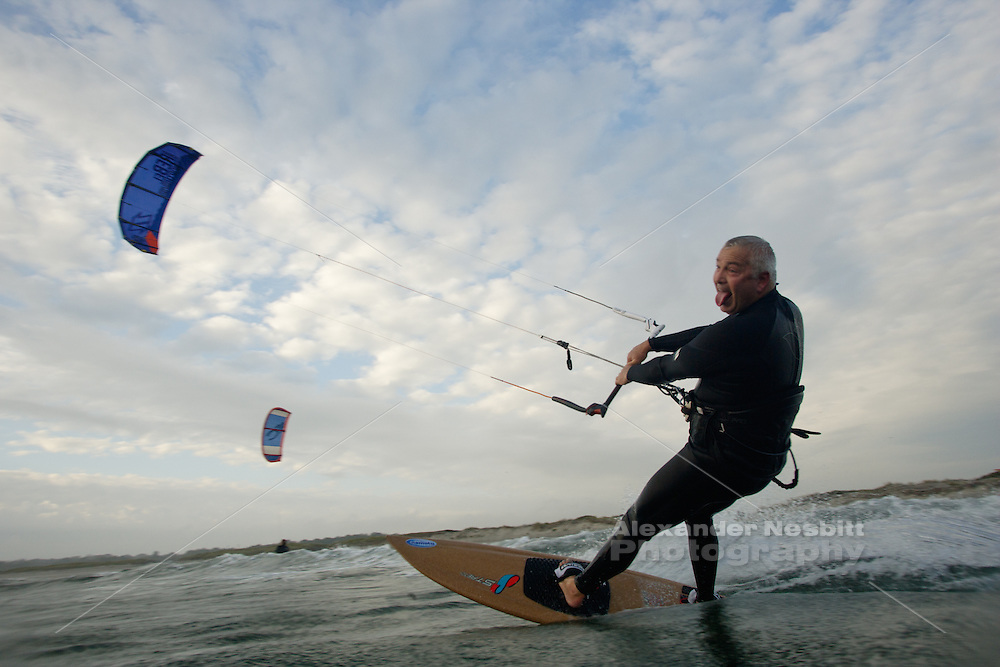 Sachuest Beach, Middletown, RI - john Boone kiting on a surfboard