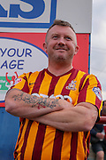 Bradford City fan during the Capital One Cup match between York City and Bradford City at Bootham Crescent, York, England on 11 August 2015. Photo by Simon Davies.
