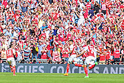 Arsenal celebrate after Alex Oxlade-Chamberlain scores during the FA Community Shield match between Chelsea and Arsenal at Wembley Stadium, London, England on 2 August 2015. Photo by Shane Healey.