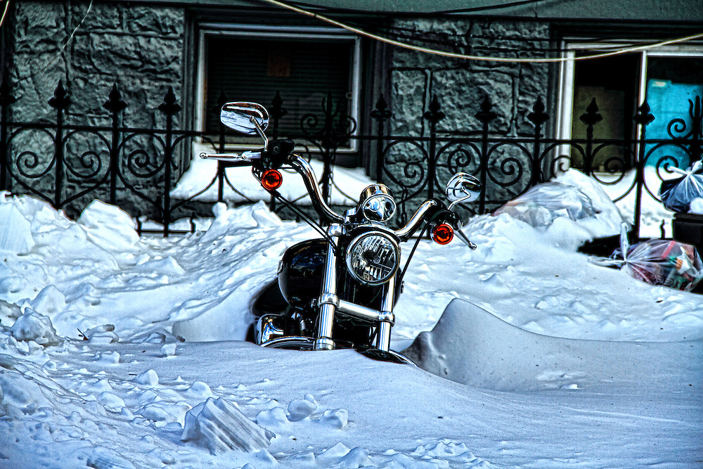 After the blizzard of late 2010, this neglected motorcycle in Jersey City will need at least a tune up.