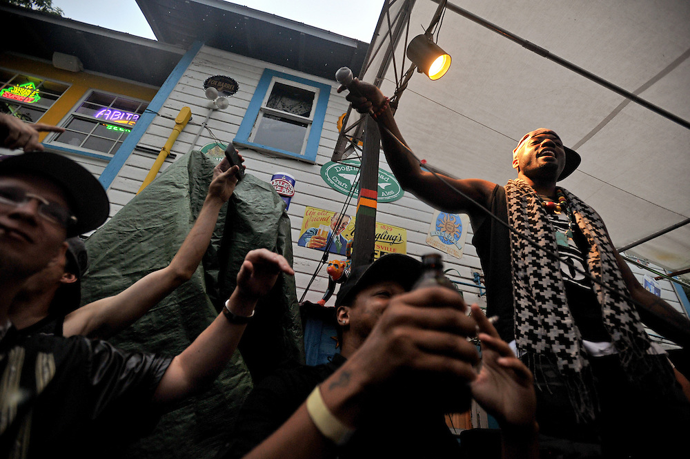Xavier Mascareñas/Treasure Coast Newspapers; Fish Scales (right) of Nappy Roots, a Southern hip-hop group, holds the mic out for the crowd to sing along June 18, 2014, at Terra Fermata Tiki Bar in Stuart.