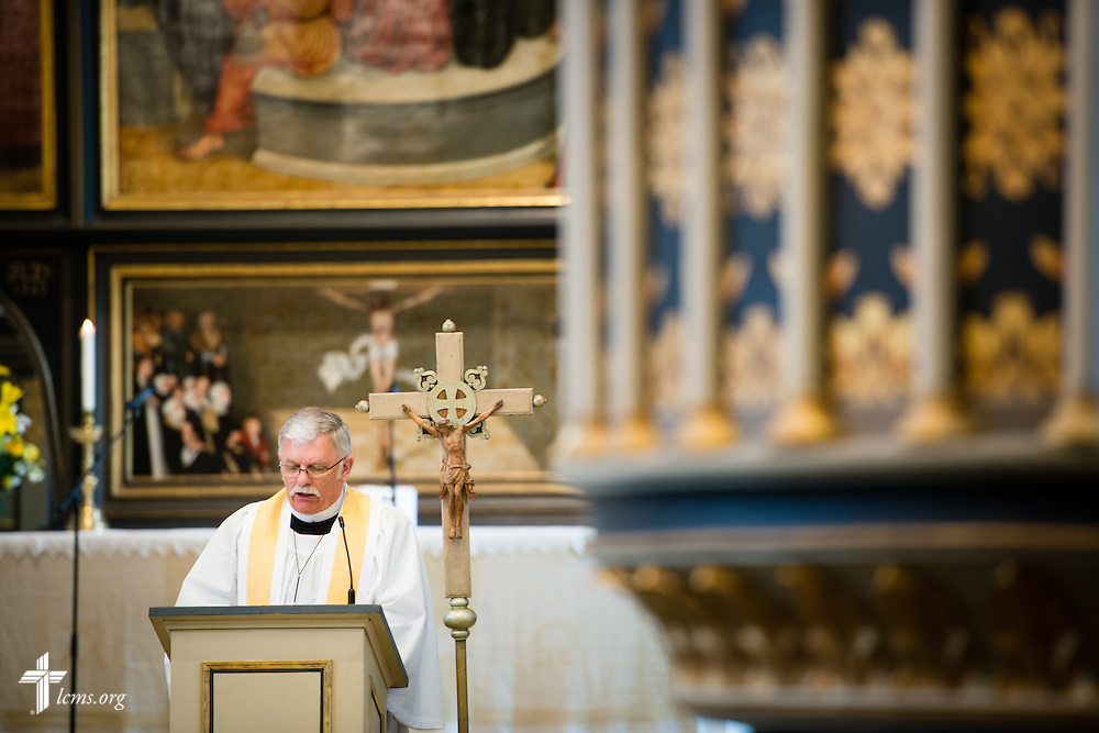 The Rev. Dr. Michael Kumm, chairman of the LCMS Board of Directors, reads during the Festival Dedication Service at the Town and Parish Church of St. Mary's before the dedication of The International Lutheran Center at the Old Latin School on Sunday, May 3, 2015, in Wittenberg, Germany. LCMS Communications/Erik M. Lunsford