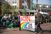 The ACRN radio station marches in the homecoming parade on Oct. 11, 2014.