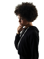 one mixed race african young teenager girl woman thinking in studio shadow silhouette isolated on white background
