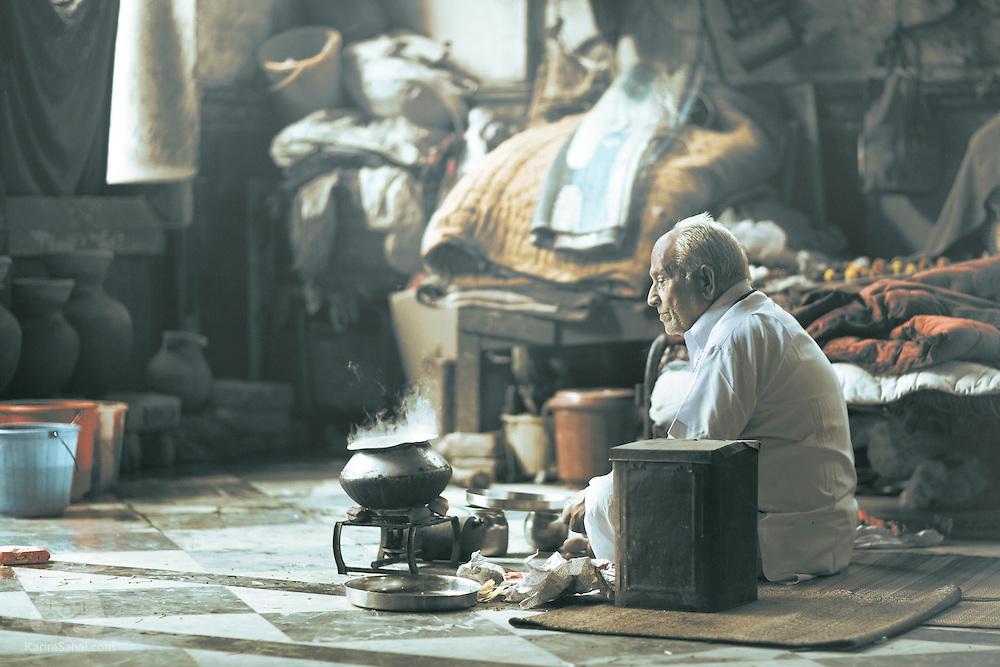 An elderly man making tea, Kolkata, west Bengal, India.