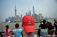 NC State's Sean Lang sports his Wolfpack pride on his head while touring The Bund in Shanghai.