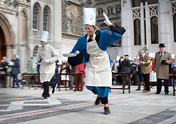 © Licensed to London News Pictures. 05/03/2019. London, UK. People take part in an inter-Livery Company pancake race in Guildhall Yard in The City of London. Participants from the Poulters, the Fruiterers, the Cutlers, Mansion House, Guildhall and Old Bailey are raising money for The Lord Mayor's Charity. Photo credit: Peter Macdiarmid/LNP