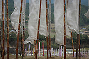 Buddhist vertical prayer flags in honor of the deceased - Buddhists believe that the prayer flags generate spiritual vibrations that are released when blown by the wind and the prayers are carried in the air like silent prayers