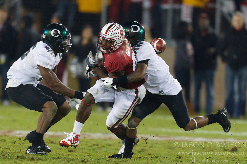 Nov 12, 2011; Stanford CA, USA;  Stanford Cardinal wide receiver Ty Montgomery (88) is unable to catch a pass that was intercepted by Oregon Ducks linebacker Boseko Lokombo (left) for a touchdown during the fourth quarter at Stanford Stadium.  Oregon defeated Stanford 53-30. Mandatory Credit: Jason O. Watson-US PRESSWIRE