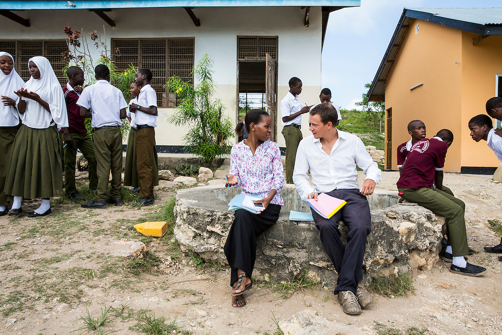 VSO volunteer Paul Jennings and local teacher Rebecca Ngovano monitoring another teacher during a geography class outside in the school grounds. Paul has been working with Rebecca for over 6 months to improve teaching methodologies in classrooms. Angaza school, Lindi, Tanzania