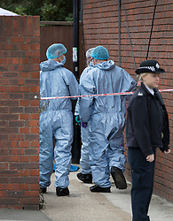 © Licensed to London News Pictures. 08/10/2016. London, UK. Forensics officers examine the scene of a shooting in Eastney Road, Croydon. Police were called to reports of a man suffering a gunshot wound at 11.30 PM on Friday night. Officers from the Homicide and Major Crime Command are investigating after the man was pronounced dead at the scene.Photo credit: Peter Macdiarmid/LNP
