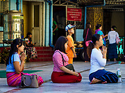 18 NOVEMBER 2017 - YANGON, MYANMAR: Women at Sule Pagoda in central Yangon. Pope Francis is visiting Myanmar, September 27-30. It will be the first visit by a Pope to the overwhelmingly Buddhist nation. He will meet with the Aung San Suu Kyi and other political leaders and will participate in two masses in Yangon. The Pope is expected to talk about Rohingya issue while he is in Myanmar. The Rohingya are persecuted Muslim minority in Rakhine state in western Myanmar. It's not clear how Myanmar's politically powerful nationalist monks will react if the Pope openly talks about the Rohingya. In the past, the monks have led marches and demonstrations against foreign diplomatic missions when foreign ambassadors have spoken in defense of the Rohingya. There is not much visible sign of the Pope's imminent visit in Yangon, which is estimated to be more than 90% Buddhist.    PHOTO BY JACK KURTZ
